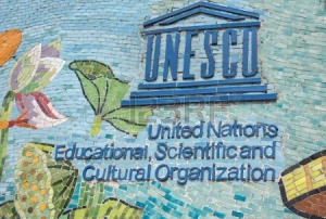 25092727-hanoi-vietnam--circa-march-2012-unesco-logo-on-longest-mosaic-wall-in-the-world-blue-logo-and-name-o