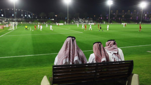 DOHA, QATAR - JANUARY 05:  Qatari fans watch the international friendly match between Al-Sailiya and Bayern Muenchen at the 'ASPIRE Academy for Sports Excellence' on January 5, 2012 in Doha, Qatar.  (Photo by Alex Grimm/Bongarts/Getty Images)